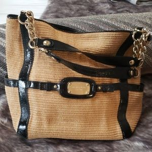 Michael Kors woven purse with gold hardware.